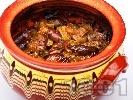 Рецепта Печени пилешки сърца с лук, чесън и доматено пюре в гювеч на фурна